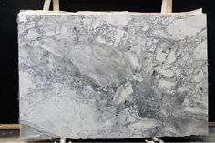 Uh oh -- this doesn't look like marble! This slab of Super White Quartzite is very grey, but is often shown as being much more white