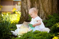 Find a lush green spot at the base of a beautiful old tree, make sure the setting sun is pouring around in the background, insert a darling one year old, and a storybook. Snap!