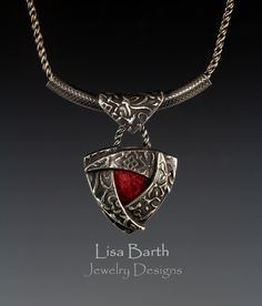 Here's a pink sapphire set in fine silver.  I fused the bail to a sterling silver tube that slides on the chain.  -Lisa