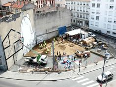 Saint-Étienne residentstransform wasteland Into public square & garden place. Now, the Place au Changement is more commonly  known to the residents as the Place of the Giant in honor of the large mural on the wall painted by Ella & Pitr. An online blog was set up to document the changes & inform residents of how to get involved. Click to read more.   Sustainable Design Innovation, Eco Architecture, Green Building