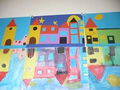 We hebben donderdag gebouwen met gekleurd papier op een blauw papier geplakt en het spiegelbeeld geschilderd.  Dit werd een mooie huizenrij ...