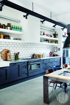 Industrial kitchen with salvaged theatre spot lights. Home Journal, November 2015.