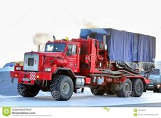 NOVYY URENGOY, RUSSIA - FEBRUARY 24, 2013: Red Kenworth T800 truck of the Halliburton oil field service company at the city street.