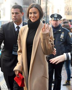 Seeing red: The Russian beauty carried a red handbag that added a flash of colour to the n...