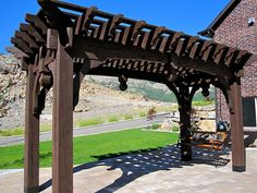 Garden Arbor swing hung from timber frame pergola with full-wrap roof.