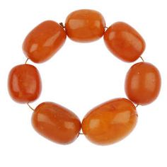 LOT:509 | A string of seven natural amber beads.