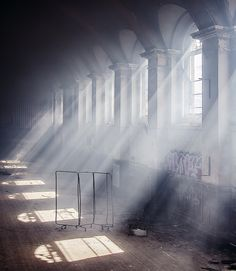 I like how this image has been composed, with the light streaming in and the pattern of the windows, continuing down.