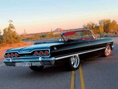 "'63 Impala convertible  I had one like this except mine was blue with a ""409"" 425hp 4speed wish I had it back."