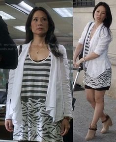 Joan's striped and zebra mixed print dress on Elementary.  Outfit Details: http://wornontv.net/20358/ #Elementary #CBS