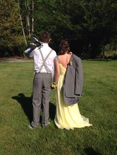 Yellow prom dress, bow tie, suspenders, grey tux. I'd say we were a pretty cute prom couple!