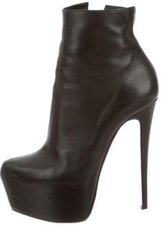 bc2e166354a Black leather Christian Louboutin pointed-toe ankle boots with concealed  platforms