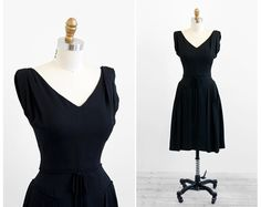 vintage 1950s dress / 1960s dress / Black Wiggle Cocktail Dress with Pleated Overskirt. $204.00, via Etsy.
