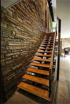 Love the wooden stairs against stone wall! #rusticfab