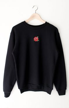 - Description - Size Guide Details: Oversized, crewneck sweatshirt in black with mini rose patch on front center. Brand: NYCT Clothing. Unisex, oversized/loose fit. Fabric & Care: 50% Cotton, 50% Poly