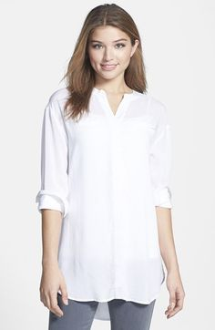 Free shipping and returns on Sandra Ingrish Two-Pocket Voile Tunic (Regular & Petite) at Nordstrom.com. Lightweight rayon voile provides soft, fluid drape for a refined tunic top styled with a split banded neckline and two faux welt pockets at the chest.