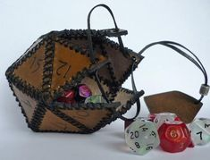Horntail Wyrm Egg Container For Lots O' Dice and Other Trinkets of Sorcery w/ Optional Soft Liner Leather dice box. The triangles from the printer, finished with holes, so you just have to sew Nerd Crafts, Diy Crafts, Dice Box, D&d Dungeons And Dragons, Craft Show Displays, Leather Projects, Leather Crafts, Diy Kits, Leather Working