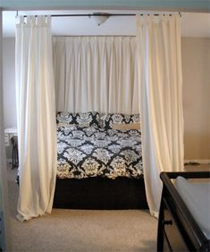 diy canopy bed -  using curtain rods above bed onto ceiling!   like how the ones at the headboard are pulled across and the ones at the foot are just in the corners.