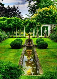 Italian influence with deep herbaceous borders either side, reflections of the surrounding trees are seen in the rill. Great ambience and mood created here.