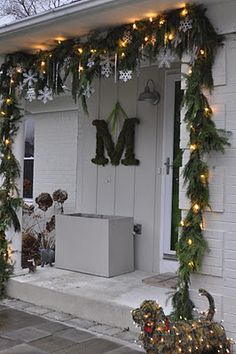 Front door garland with icicles and snowflakes rather than round ornaments. This would be a great decoration all winter long, not just during the holidays.