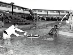 Floating breakfast in the Dunes Hotel & Casino swimming pool on the Las Vegas Strip, 1955 vintage photo.