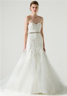 Strapless fitted and flared tulle gown accented on bodice and upper skirt with lace, organza, and crystals; Color sampled: Silk White
