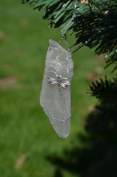Genuine frosted white sea glass Christmas ornaments with silver dragon fly charm. Genuine frosted white sea glass ornament. Dress up your Christmas
