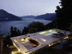 Concrete house in Brissago, Switzerland by Wespi de Meuron Romeo Architects - a pool terrace with sunken bar Casa Patio, Backyard Patio, Design Exterior, Casas Containers, Architect House, Rooftop Terrace, Stone Houses, Cool Pools, Pool Designs