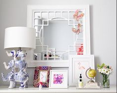 White vanity styling. Love the blue and white elephant lamp and the flamingo print
