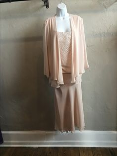 Pictured in Stone. Also available in 3 other colors. Four piece outfit includes jacket, top, skirt and pants.