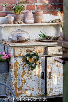 The worn chipped looks adds beauty to a vintage cabinet