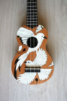 A little ukulele painted and illustrated on as a gift, featuring South African birds. It's fully functioning, sounds and looks good too. By Lauren Schultz.