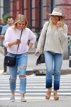 City girls: The ladies crossed the street in Soho to do some shopping after brunch...