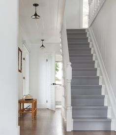 Best overall inspo, but stairs painted differently. Handsome bones, charming quirks, an intriguing backstory — there are plenty of reasons to love an older house. Painted Staircases, Painted Stairs, Spiral Staircases, White Staircase, Staircase Design, Staircase Ideas, Escalier Design, Staircase Makeover, Small Hallways