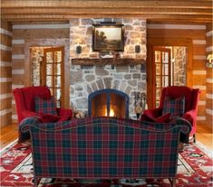 , Rustic Living Room With Dark Green And Red Plaid Couch Color Also Elegant Padded Armchair With Red Color Also Plaid Cushions Also Traditional Stone Fireplace With Natural Wooden Mantelpiece And Glass Door: Plaid Carpet and Any Other Plaid Products Plaid Couch, Tartan Decor, Tartan Plaid, Scottish Decor, Log Cabin Kitchens, Cozy Cabin, Cozy Cottage, Rustic Design, Log Homes