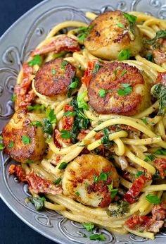 This Creamy Tuscan Spaghetti with Jumbo Scallops is one of our favorite scallop recipes! Skip dining out and have your seafood dinner right at home! Pasta Dinner Recipes, Easy Salad Recipes, Seafood Recipes, Gourmet Recipes, Seafood Scallops, Seafood Pasta, Seafood Dinner, Seafood Buffet, Seafood Platter