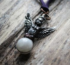 Mythic in her lifelike detail, this little pewter harpy hangs from a length of vegan suede in your choice of colours. She grips a full moon of moonstone in her talons, wound around with antiqued copper. She resembles Lilith in the Burney relief at the British Museum-- she is also known as the Queen of the Night. Necklace is 30 long with an adjustable knot. Please choose the colour of suede you would like from the drop down menu.
