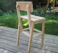 """Outdoor Cedar """"Higher Chair""""   Do It Yourself Home Projects from Ana White (""""Brag Post"""").  This is not a bad design. Wonder if it could be tweaked to be a regular-sized adult chair?  (and Maybe even a stackable version?)"""