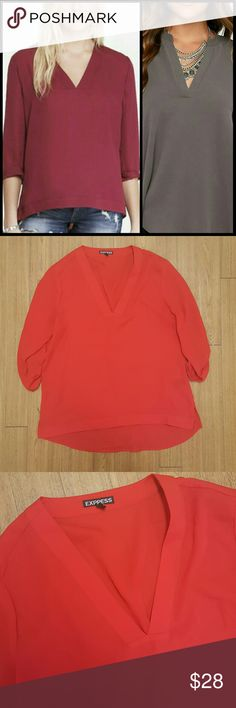 Express low v neck blouse This top has been worn twice, and is in excellent condition. It is high low and loose fitting. Has a deep v neck line. Bright red color, perfect for fall and holidays! Express Tops Blouses