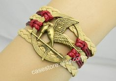 Mockingjay pin braceletBronze leather by charmcover on Etsy, $7.99