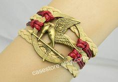 Mockingjay pin braceletBronze leather by charmcover on Etsy, $7.99