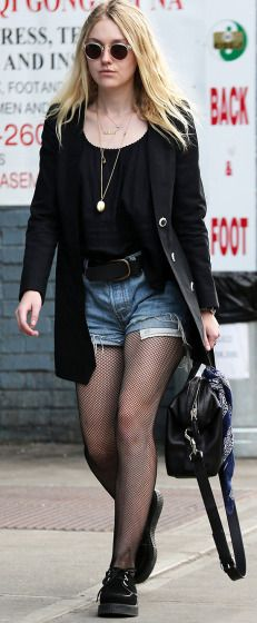 Dakota Fanning goes for a walk in Soho on Tuesday.