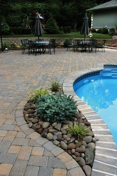 cst paver patio swimming pool deck - like the stones inside landscaping...and I like the placement near the pool...