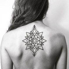 Mandala flower on back by Alex Treze
