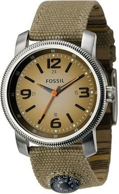 The simple, utilitarian Fossil Compass Watch. Features a clean design and a mini compass sewn into the strap. $75