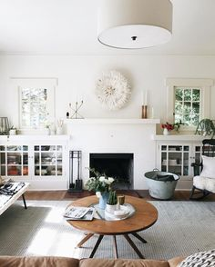 circle coffee table and white painted fireplace