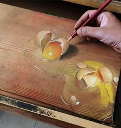 Using pencils and pastels, Singapore-based artist Ivan Hoo produces amazingly hyperrealistic illustrations drawn directly on the surface of wood.