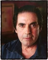 'Francesco was in his mid to late forties, about average height with a frame that suggested a love of the good Italian life; his skin was tanned but quite smooth save for the crinkly little lines which appeared around his kind brown eyes whenever he smiled, and he smiled a lot.'  David Proval as Francesco.
