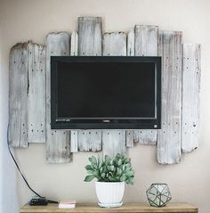 the accent wall Consider putting wood panels behind your TV. This adds depth and cool contrast.