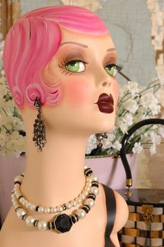Vintage Style FANTASY FLAPPER MANNEQUIN HEAD -PINK 18 inches tall. $199.99, via Etsy.