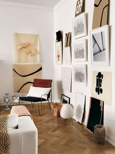 When your collection is brimming with new pieces, find creative ways to use what you have, including other framed works. Extra space can always be utilized, and those added pieces can give your display a super casual-cool vibe.